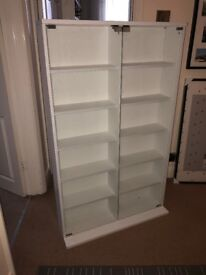 White display cabinet with magnetic catch glass doors.