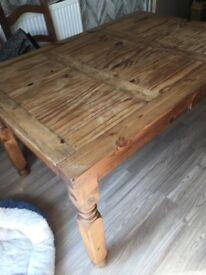 Farm house table and 4 chairs. Chairs need new covering