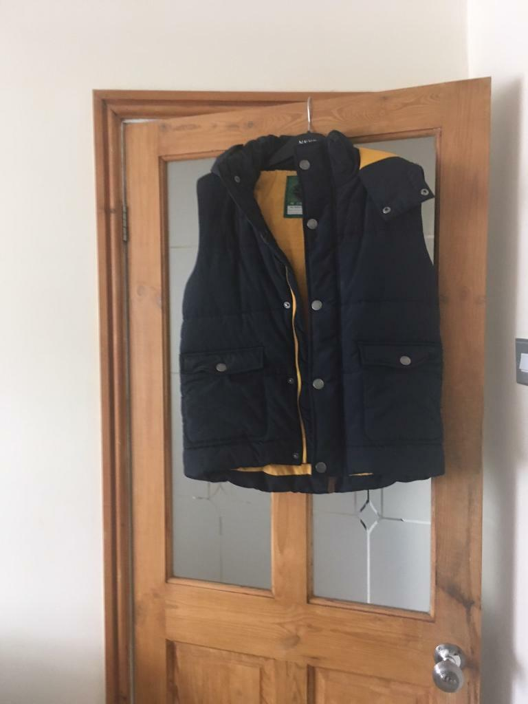 Two boys age 14 body warmers like new