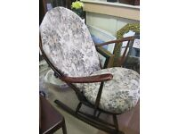 VINTAGE QUALITY 'ERCOL' WIDE SEATED ORNATE ROCKING CHAIR. FITTED DETACHABLE CUSHIONS. DELIVERY POSS