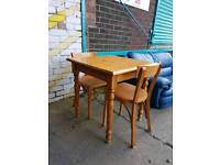 Small pine dining table with two chairs
