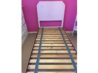 Heavy solid wood single bed (excl matress)V.good condition