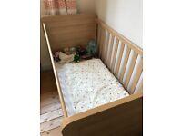 Mama's and Papa's cot bed.