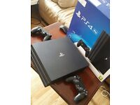 Playststion 4 Pro with 2 controllers and game.Like new