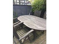 Garden table with four reclining chairs