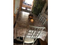 Dining room table and 6 chairs with matching furniture.