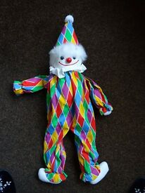 Clown doll, 28 inches in length, very brightly coloured, brand new. FOR SALE, £5.