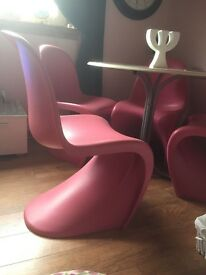 Modern pink dining chairs.