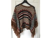 Women's poncho. Tag says large but would fit sizes 10-14
