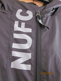 Newcastle United fleece lined rain jacket (official merchandise) Size LB32-34 Approx age 12-15