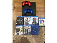 PS4 slim bundle 2 controllers and 7 games