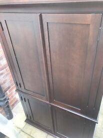 Large mahogany to unit, solid wood bought from pottery barn. Second hand but in fabulous condition.