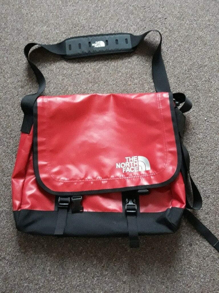 North Face large red PVC Messenger bag as NEW condition