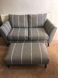 Grey 2 seater sofa and foot stool
