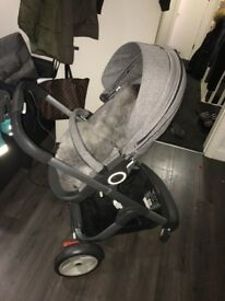 Stokke Crusi pushchair with Grey faux fur lining, raincover &cup holder