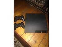 PS3 slim for sale 6 games and 2 controllers