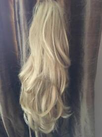 Blonde clip on hairpiece.. new..