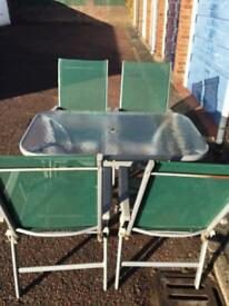 Four-piece garden table and chairs set
