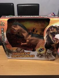 Brand new battery operated dinosaur
