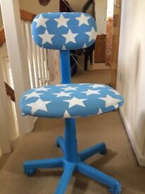 Blue desk chair, ideal for a child.
