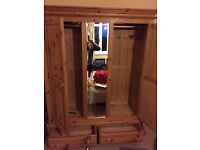 Double Wardrobe with center mirror panel, good quality & condition. Stockport £75ono buyer collects.
