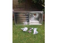 Stainless steel kitchen sink - left hand drainer