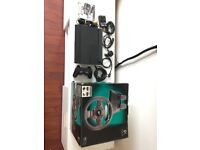PlayStation 3 Super Slim 500 GB comes with Logitech Driving ForceGT steering wheel set & Wheel Stand