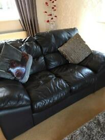 2 seater brown leather sofa...