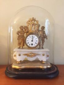 French rococco marble clock under a glass dome