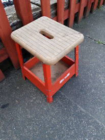 small metal framed stool with wood top
