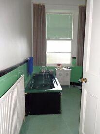 Original Art Deco bathroom suite in dark avocado black Italian glass side and end panels to bath