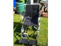 Clean tidy medium wheel chair seat belt fold up for transport