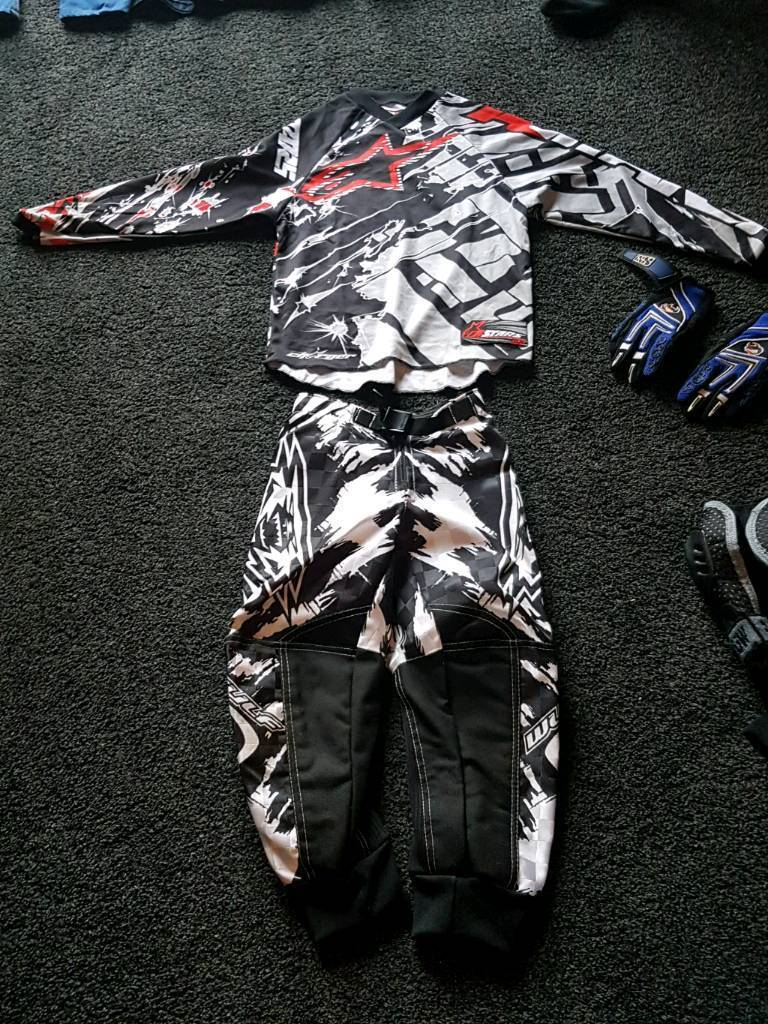 Wulf motocross boots body suit gloves and armour top all