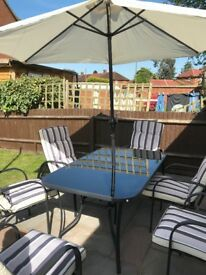 Patio set 6 recliner chairs parasol 2 footstool s and a drinks table 1 month old