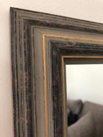 Mirror in decorative frame