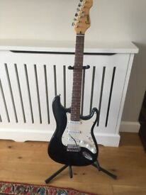 Guitar and stand .Encore , colour black