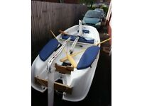 As new condition Clam / Ezy Boat with sails, oars, outboard motor and inbuilt trailer