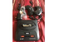 Sega Megadrive 2 with game and leads. (2 available)
