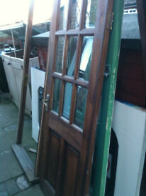 Exterior hardwood door with clear bevelled glass and frame