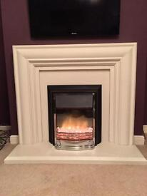 Electric fire with white surround and hearth