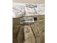 Two pairs of Topman Skinny chinos 32R and one pair of Topman stretch skinny black jeans 32s.