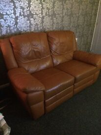 1 electric leather reclining sofa also small sideboard.