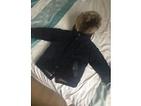 Selling a brand new boys coat from Next