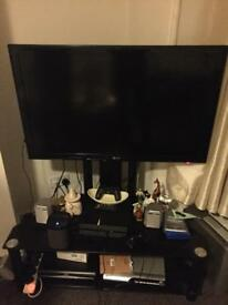 "LG 42"" TV with black glass stand"