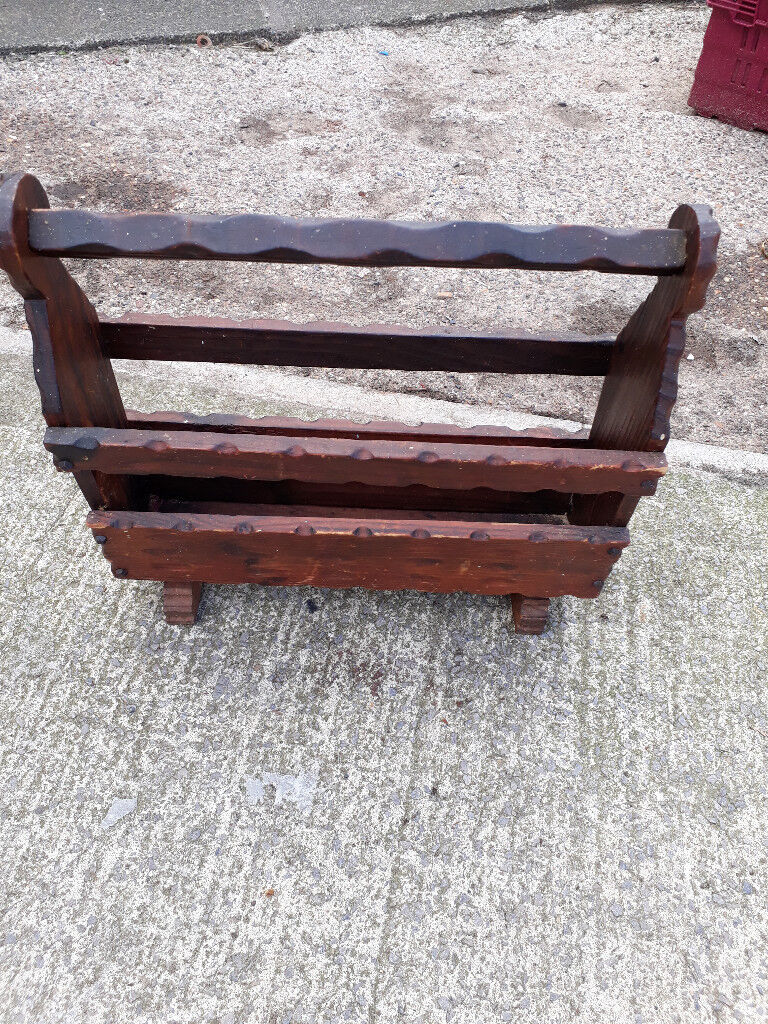 brown wood carved magazine rack