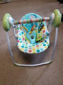 Hi i am selling baby bunser swing