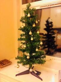 Small pre lit Christmas tree with baubles