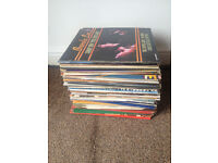 stack of vinyl mainly country records all records in good condition.