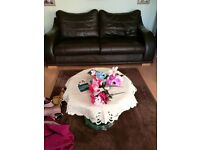 A 3 seater and 2 seater brown leather sofas