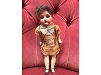 An antique bisque doll.